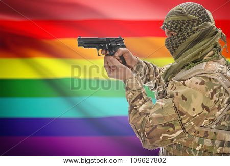 Male In Muslim Keffiyeh With Gun In Hand And National Flag On Background - Lgbt People Flag
