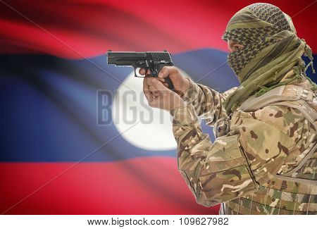 Male In Muslim Keffiyeh With Gun In Hand And National Flag On Background - Laos