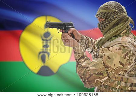 Male With Gun In Hand And National Flag On Background - New Caledonia