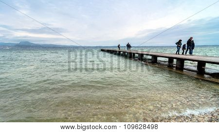 Wooden Pier And Sky Over Garda Lake - Italy