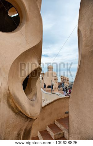 BARCELONA, SPAIN - MAY 01. Rooftop at Casa Mila (also known as La Pedrera) on May 1, 2015 in Barcelona. Terrace of the Casa Mila, with chimneys shaped anthropomorphic soldiers, created by Gaudi