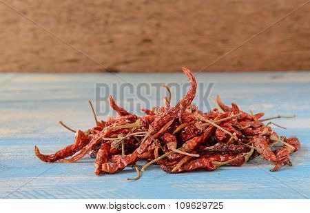 Red Chili On Blue Wooden Floor.
