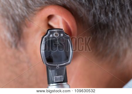 Doctor Checking Ear Of Male Patient