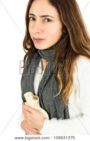 Woman In Pain Holding A Hot Water Bottle
