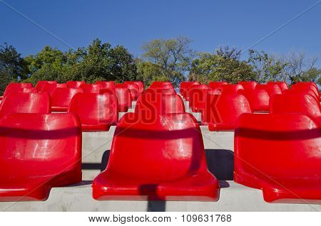 Empty Red Stadium Seats In An Open Space
