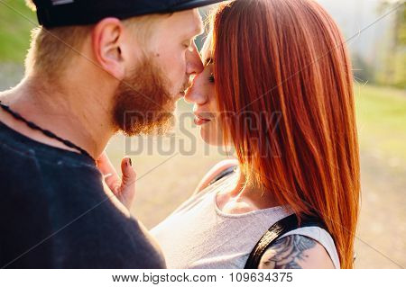 beautiful couple in the mountains close angle
