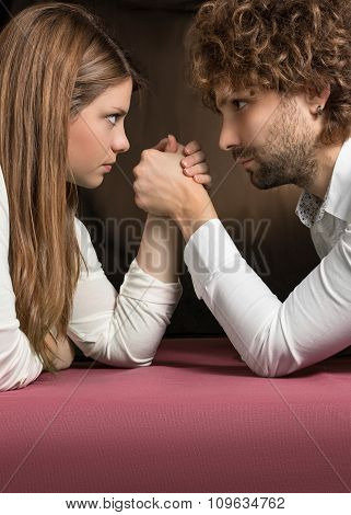 man and woman on pink table