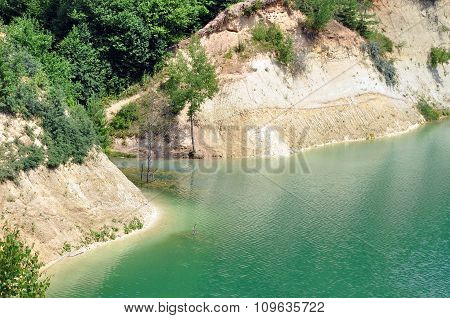 Industrial quarry with turquoise water
