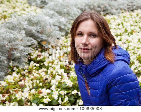 Young Beautiful Girl Near Flower Beds