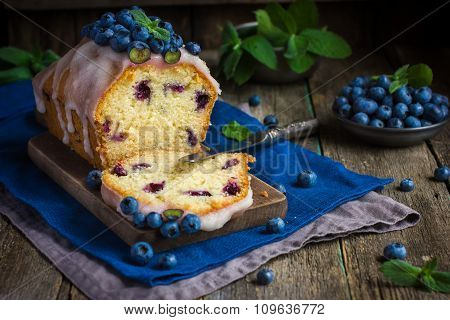 Blueberry Cake With Sugar Icing And Fresh Berries