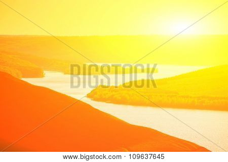Beautiful bright sunset over the river  in mountains