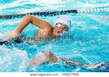 Teen Boy Competing At Swimming Gala.