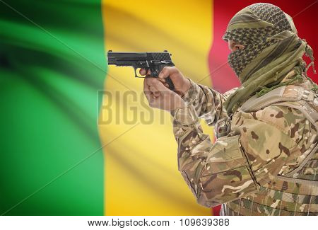 Male With Gun In Hand And National Flag On Background - Mali