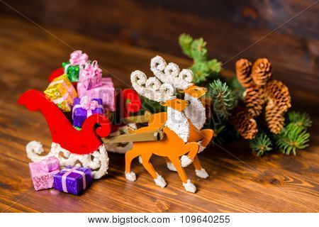 Composition Of Christmas Decoration Reindeer And Santa Sleigh Hand Made With Gifts, Branch Fir Tree,