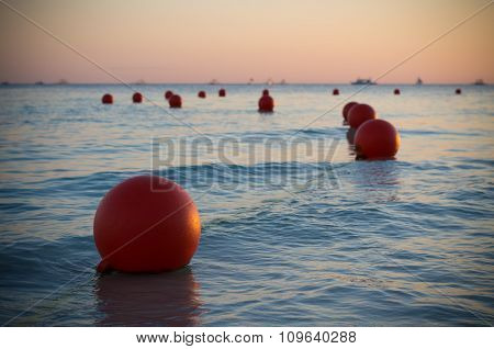 Buoys At Sunset