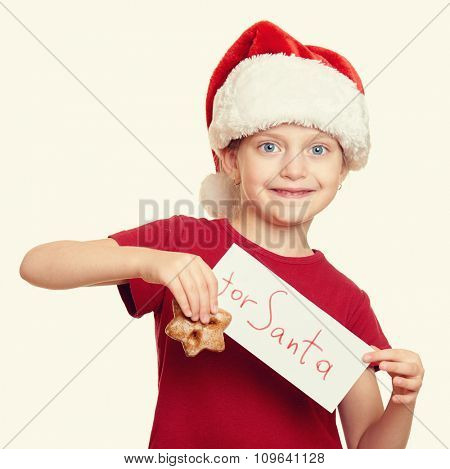 girl in santa hat with cookies - winter holiday christmas concept