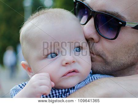 Father Kisses His Son