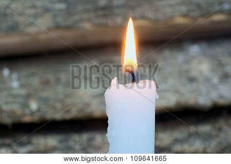 Macro Of Burning Candle On The Background Of Wood