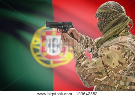 Male In Muslim Keffiyeh With Gun In Hand And National Flag On Background - Portugal