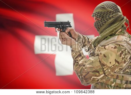 Male In Muslim Keffiyeh With Gun In Hand And National Flag On Background - Switzerland