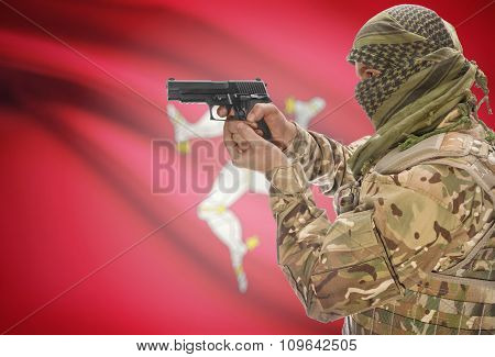 Male In Muslim Keffiyeh With Gun In Hand And National Flag On Background - Isle Of Man