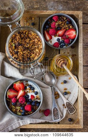 Granola With Fresh Berries And  Yogurt  On Wooden Tray