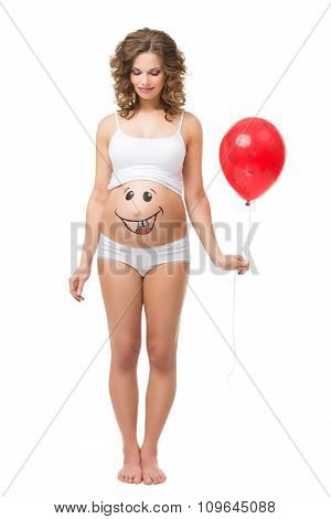 Pregnant woman with air balloon