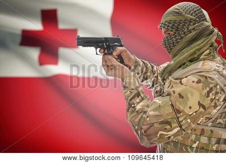 Male In Muslim Keffiyeh With Gun In Hand And National Flag On Background - Tonga