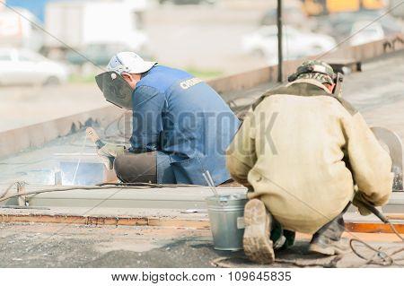 industrial worker welders during working process