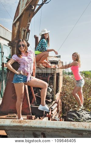 Beautiful women on old harvester in field