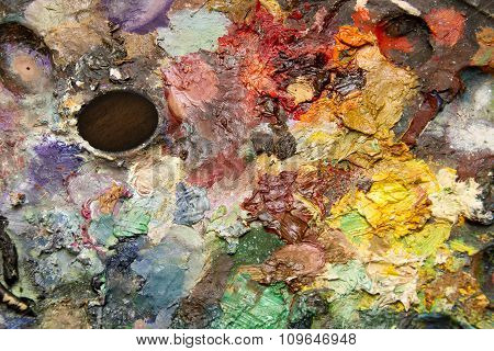 fragment of the artist's palette with mixed paints
