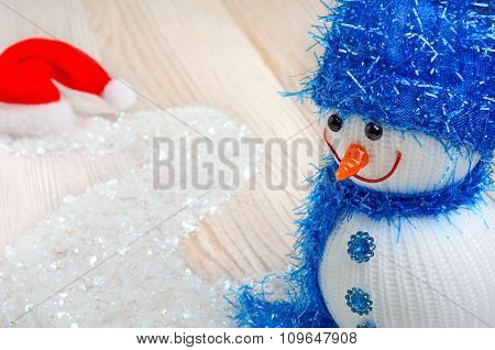 Snowman On The Background Of Christmas Snow