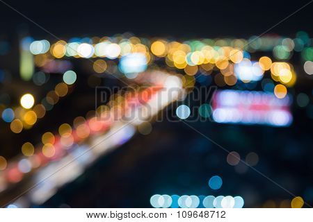 Abstract blurred bokeh light road curved at night background