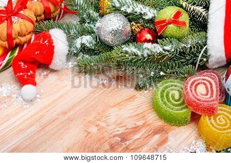 Christmas Background, Hat Santa Claus, Pine Twig, Biscuit And Jellies.