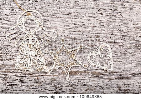 Handmade Art Figurines Like Angel Star And Heart On Wooden Background