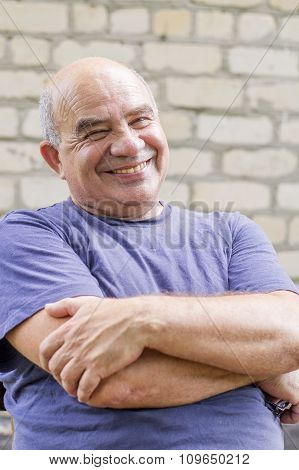 Laughing Old Man With His Arms Crossed