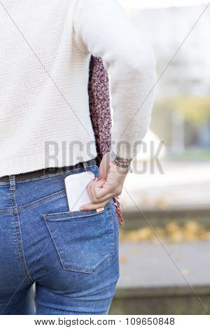 Woman Hand Cell Smart Phone In Back Pocket, Modern Lifestyle Concept.