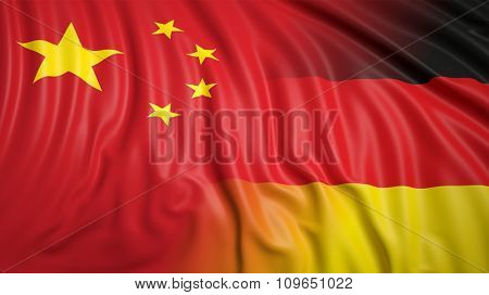 Close-up of Chinese and German flags