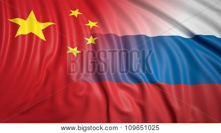 Close-up of Russian and Chinese flags