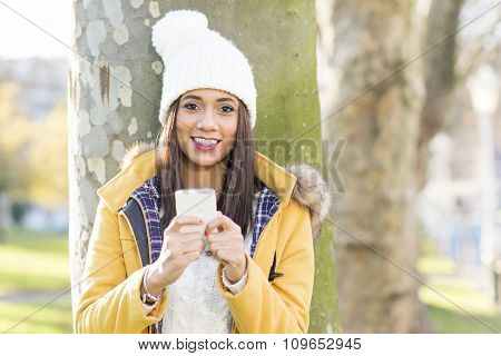 Portrait Of Happiness Woman With Hat Holding Phone, Outdoor.