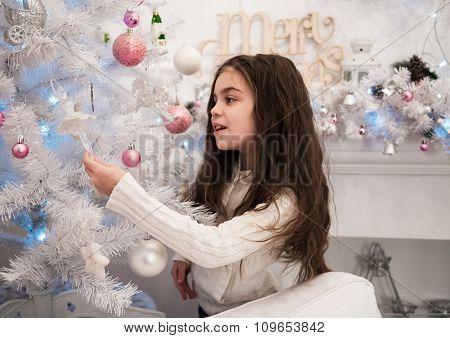 Little Girl Decorating Christmas Tree