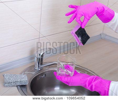 Woman Washing Dishes Wih Dirty Sponge