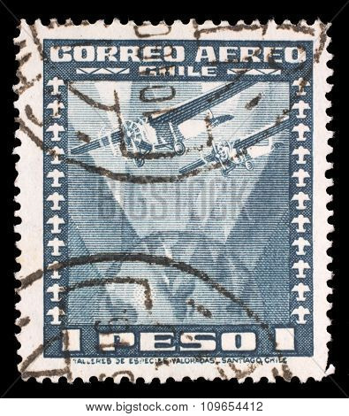 CHILE - CIRCA 1934: A stamp printed in Chile shows Fokker Super Universal Aircraft over Globe, circa 1934.