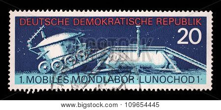 GDR - CIRCA 1971: stamp printed in East Germany shows the soviet moon machine Lunokhod - 1, circa 1971