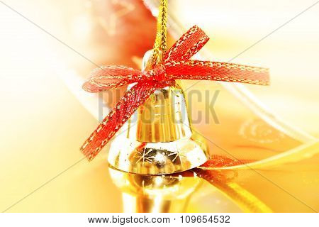 Golden Christmas Decoration On Shiny Background. Holiday Background Or Greeting Card. Selective Focu