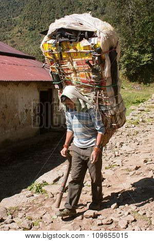 Sherpa Porters With Goods Way To Everest Base Camp