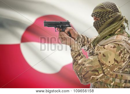 Male With Gun In Hand And National Flag On Background - Greenland