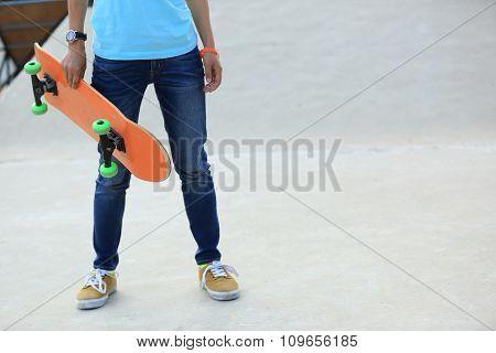 skatebobarder with skateboard