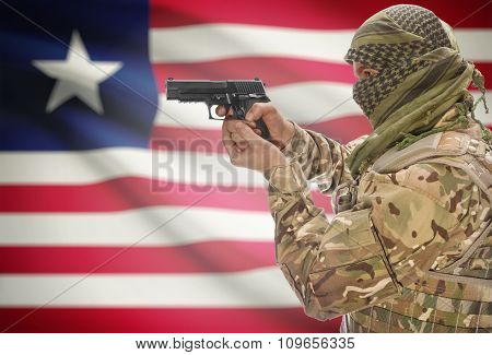 Male With Gun In Hand And National Flag On Background - Liberia