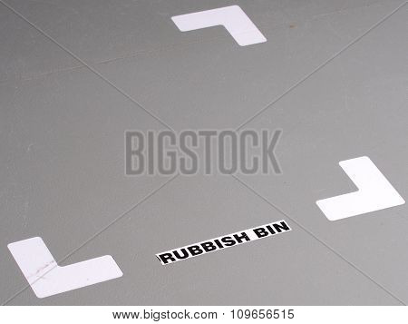 Organized industrial floor with tape markings and label for position of a rubbish bin